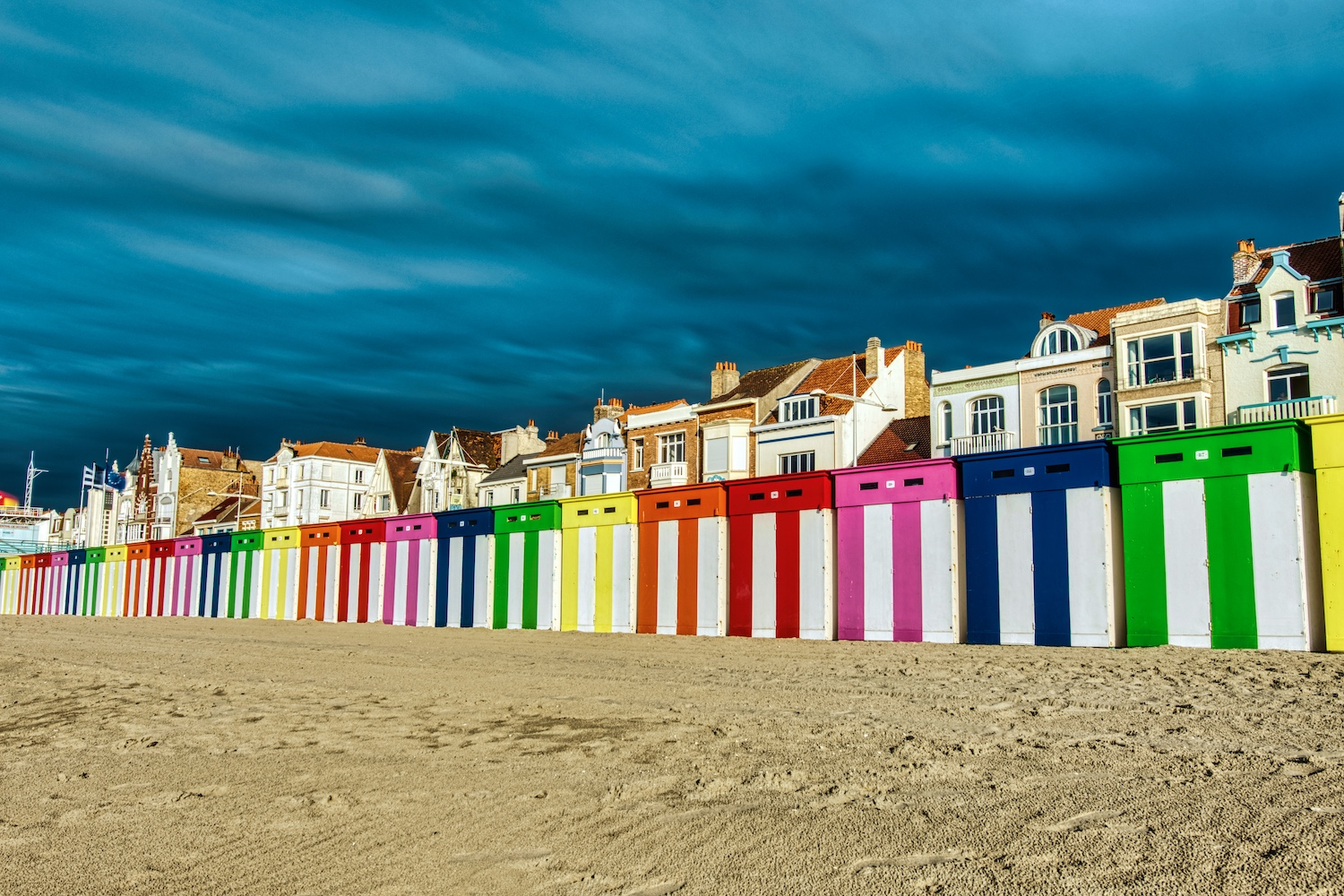 Bath cabins on the beach of Dunkerque in front of a threatening rain front