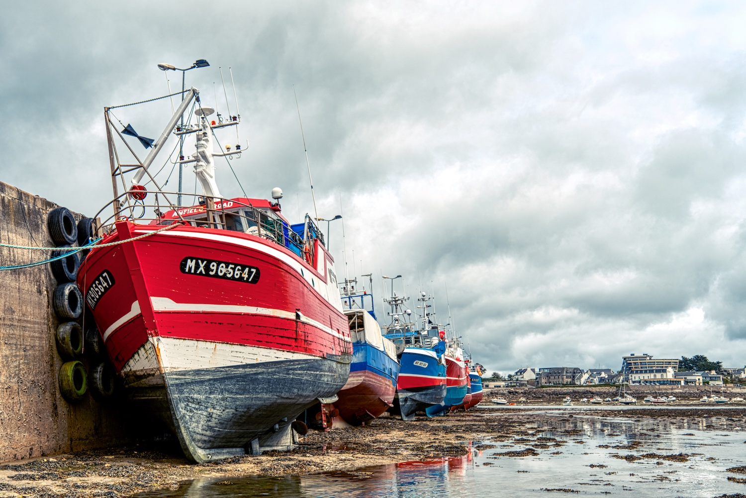 Fishing boats are waiting for the tide in the port of Roscoff