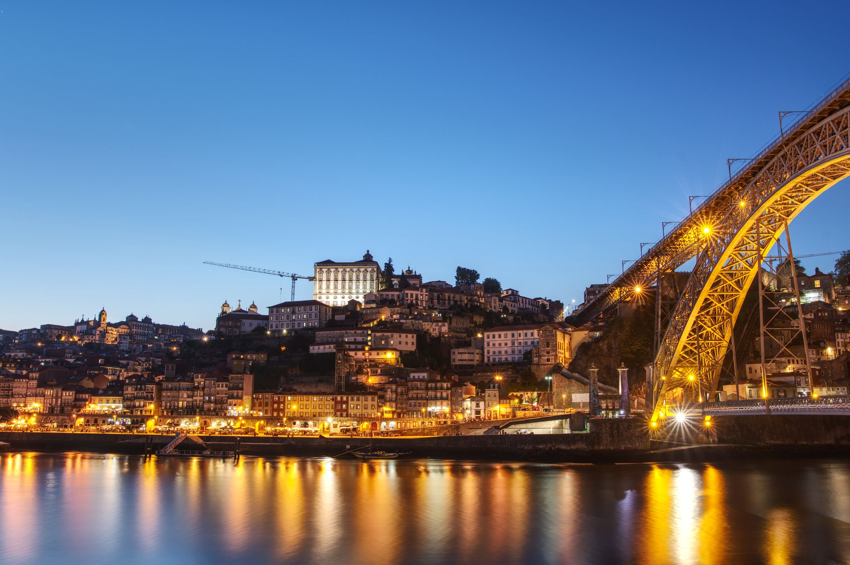 "View of Porto and the bridge ""Ponte Luíz I"" at the beginning of the blue hour"