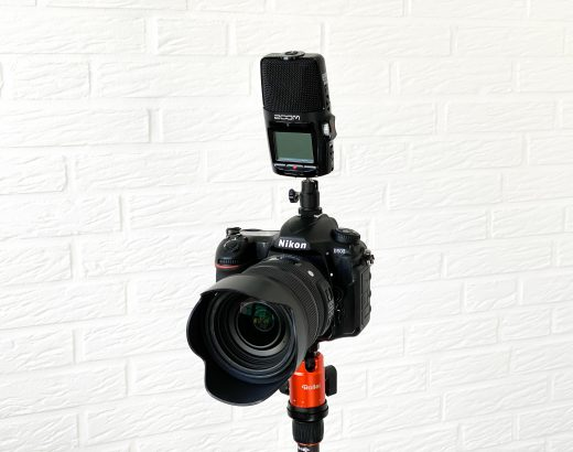 Connect Zoom H2n audio recorder to DSLR camera and use as microphone.
