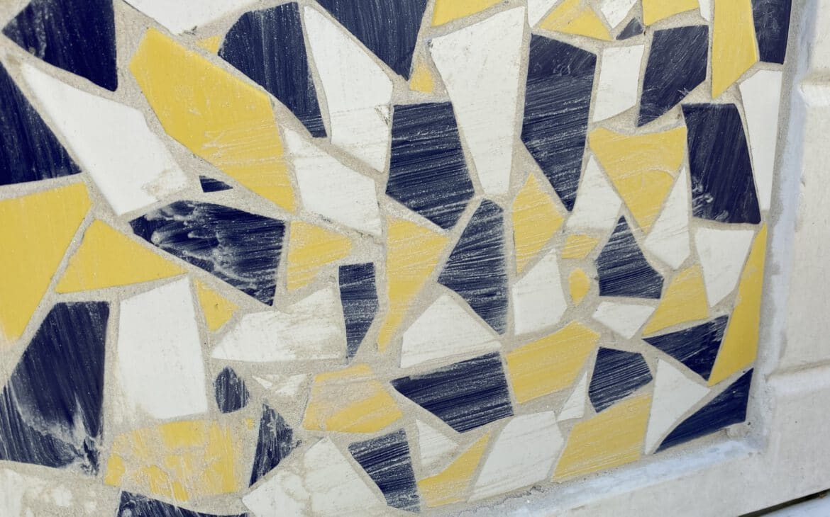After grouting, simply wipe off the excess grout with a wet cloth.